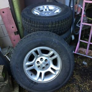 4 tires Cooper Discovery Studded M s 265 70 r16 Mounted On 2004 Dodge Rims