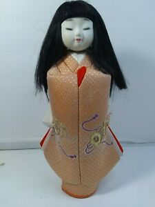 Vintage 12 Asian Japanese Doll With Porcelain Face Fabric Body On Wood