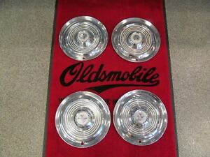 1954 1955 Oldsmobile 88 98 Used 15 Inch Deluxe Spinner Wheel Cover Hubcap Set 4