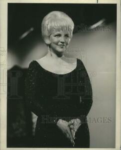 1965 Press Photo Peggy Lee with a pleasant look on her face wearing a dark dress $19.99