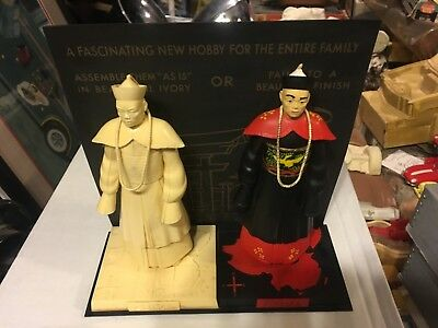 aurora store display model 1950s chinese guys base, background 2 men vintage old