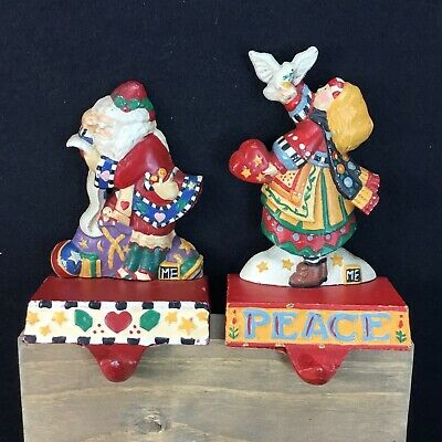 Mary Engelbreit Midwest Of Cannon Cast Iron 2 Stocking Holders Santa Angel Peace