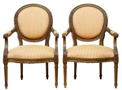 Pair Of 19th Century Carved French Walnut Open Armchairs