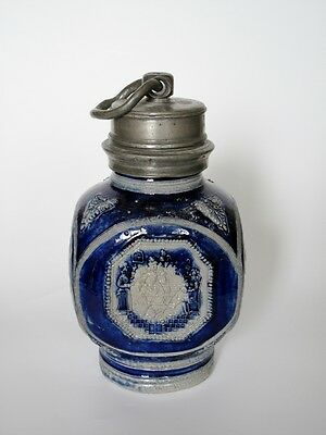 A Very Rare And Interesting Westerwald Square Bottle With A Smokers Scene 1670