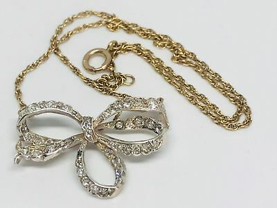 edwardian diamond set pendant in the form of a ribbon 9ct gold chain