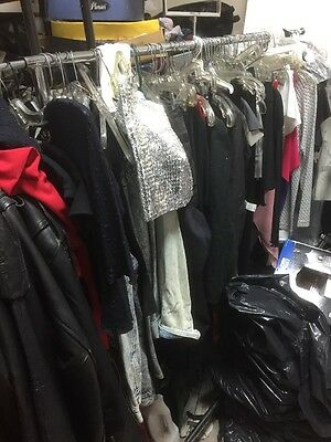 3 clothing racks full of mens and womens pants, shirts, dresses,skirts
