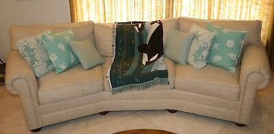 Curved Sofa Sectional With Seafoam Colored Throw Pillows In Ocean Theme