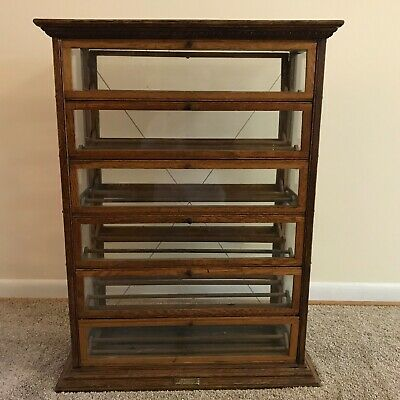 antique a.n. russell and sons oak ribbon display cabinet