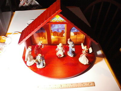 Nativity Scene With Ceramic Figures And Wood Shelter