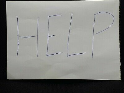 Help Message On A White Piece Of Paper