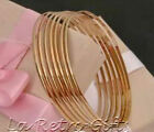 Semanario Set of 7 14K Gold Overlay Bangle Bracelets