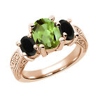 2.13 Ct Oval Green Peridot Black Onyx 925 Rose Gold Plated Silver 3-Stone Ring