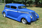 Ford: 2 Door Slant back 2 Door shaved door handles with remote opener. For sale 1937 ford 2 Door Slant back Street Rod. Steel body chopped top Rod.