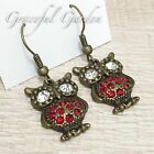 ER2444 Graceful Garden Vintage Style Bronze Tone Crystals Paved Owl Earrings