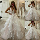 Beach Wedding Dresses A Line V-Neck Backless Appliqued Puffy Tulle Bridal Gowns
