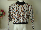 Women sweaters Mainly white  with black orange M or L 100 cotton made USA