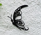 Black finished solid metal butterfly garden wall art looks great indoors too