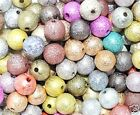 assorted stardust round acrylic beads in various sizes