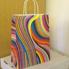 COLOURED AND COLOURFUL PAPER CARRIER BAGS WITH TWISTED PAPER HANDLES