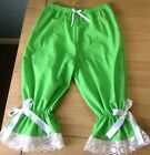 Bright lime green bloomers with tiny white dots