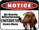 An Overly Affectionate Coonhound Lives Here 9 x 11.5 Laminated Sign