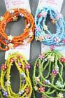 CARD OF SIX BEAD AND DAISY BEAD BRACELETS - BNIP