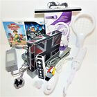 Nintendo Wii console starter bundle + Skin + Games + Accessories + Free UK p&amp;p <br/> Includes New accessories + Free 12 month warranty
