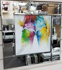 Multi coloured lady's bum & hands with liquid art & mirror frame pictures.