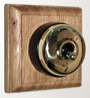 Period Single Oak Pattress with Plain Brass Black Ceramic Dolly Light Switch