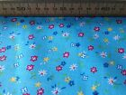 FLORAL POLYCOTTON FABRIC - SMALL STAR FUNKY FLOWERS BLUE BACK -  RED YELLOW NAVY