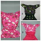 SassyCloth one size pocket cloth diaper with hello kitty print.