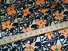 ORANGE FLOWERS ON BLACK AND WHITE POWDER TOUCH VISCOSE FABRIC sewing crafts
