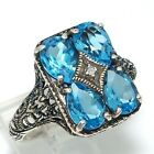 Sterling Silver 2.5ctw Pear Cut Blue Topaz Diamond Accent Filigree Ring