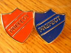 Prefect pin badges. Red or Blue with silver writing. School badge.