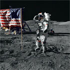Poster / Leinwandbild Apollo 17 astronaut salutes the United States flag o...