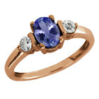 1.03 Ct Oval Blue Tanzanite White Topaz Rose Gold Plated Sterling Silver Ring