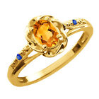 0.42 Ct Oval Yellow Citrine Blue Sapphire Yellow Gold Plated Silver Ring