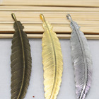 5-100pcs  The ancient silver lovely delicate heavy feather charm pendant!
